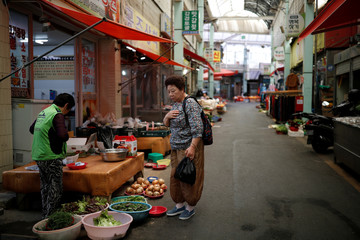 A woman shops at a traditional market in Ulsan