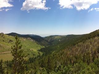 Colorado blue sky over mountain valley in Summer