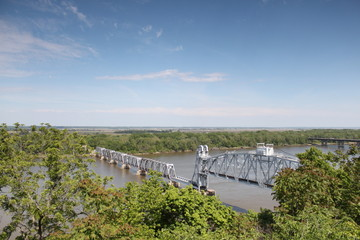 Train bridge over river from elevated view