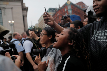 Counter-demonstrators shout during a white nationalist-led rally marking the one year anniversary of  the 2017 Charlottesville 'Unite the Right' protests in Washington