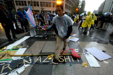 Demonstrators walk near a white nationalist-led rally in Washington