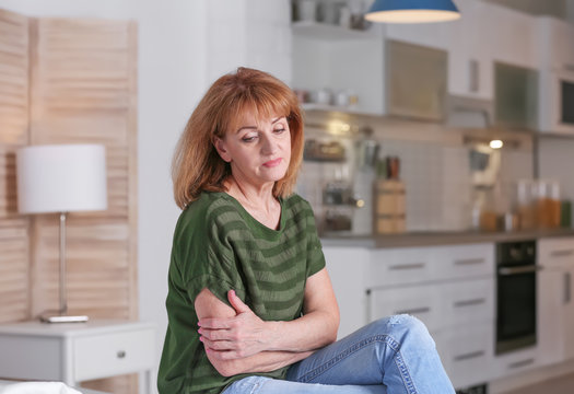 Senior woman suffering from depression at home