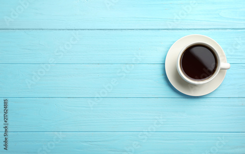 Ceramic cup with hot aromatic coffee on wooden background, top view ...