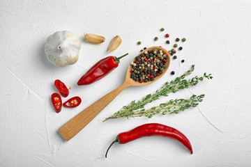 Flat lay composition with different aromatic spices on light background