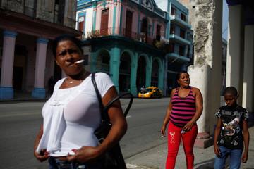 People walk along a street in Havana