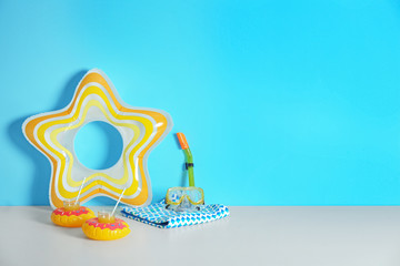 Beach objects near color wall with space for design. Summer vacation