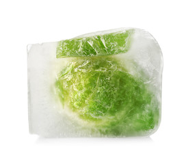 Brussels sprouts in ice cube on white background. Frozen vegetables
