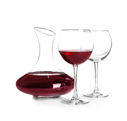 Elegant decanter with red wine and glasses on white background