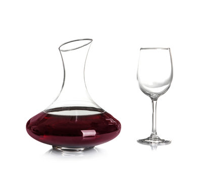 Elegant decanter with red wine and empty glass on white background