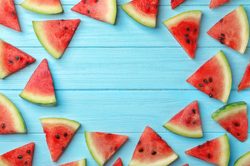 Slices of watermelon on wooden background, flat lay composition with space for text
