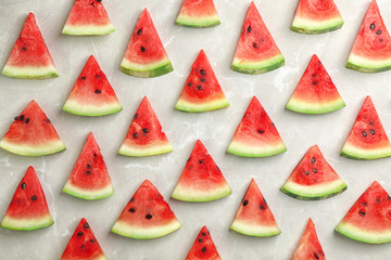 Flat lay composition with slices of watermelon on gray background