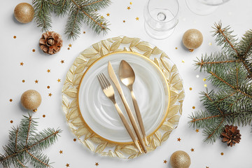 Elegant table setting on light background, top view. Christmas celebration