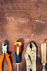 Working tools on wooden rustic background. top view with copy space.Vertical image.