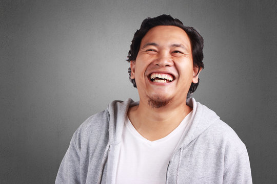 Young Man Laughing Hard Expression