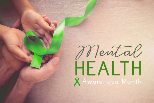 Adult and child hands holding Lime GreenRibbon, Mental health awareness month