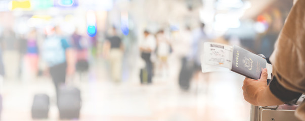 Closeup of girl holding passports and boarding pass at airport , panorama Fototapete
