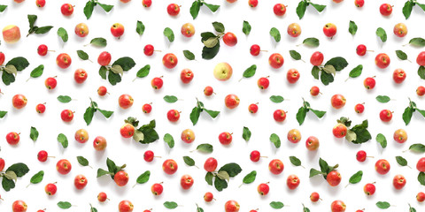 Fototapete - Seamless pattern of fresh red  apples with green leaves isolated on a white background, top view, flat lay. Food texture.