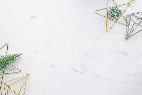 Top view of luxury marble christmas ,star, diamond, with tree Christmas on table top,Flat lay luxury holiday celebration still life,mock up for adding text,copy space, creative concept, nordic style.
