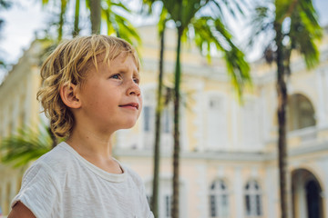 Boy on background of Old Town Hall in George Town in Penang, Malaysia. The foundation stone was laid in 1879