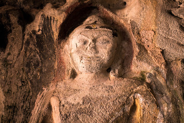 Amazing ancient Buddha statue on the wall of Thailand cave.
