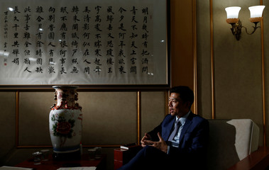 Qu Yuhui, Minister-Counselor at the Chinese embassy in Brazil attends an interview with Reuters in Brasilia