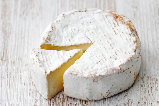 Brie type of cheese. Camembert cheese.