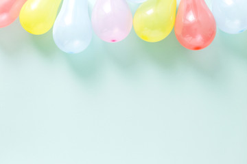 colorful balloons Pattern decoration party pastel blue background flat lay top view