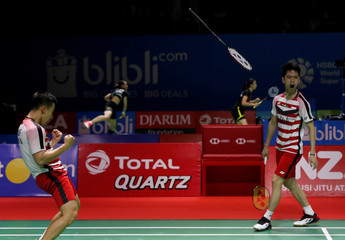 Indonesia double player badminton Marcus Fernaldi Gideon and Kevin Sanjaya Sukamuljo react as they win in Jakarta