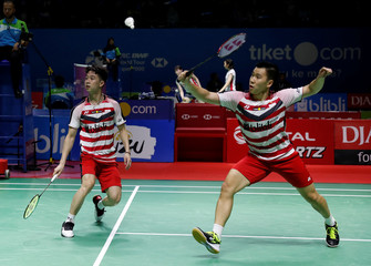 Indonesia double player badminton Marcus Fernaldi Gideon and Kevin Sanjaya Sukamuljo plays against Denmark's player during Indonesia Open championship in Jakarta