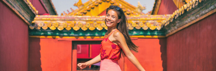 China travel Asian woman tourist smiling happy in Beijing city, panoramic banner young people lifestyle.