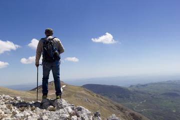 Hiker on the summit of a mountain