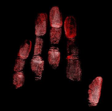 Handprint on black background, red color.