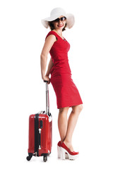 beautiful girl with suitcase and hat going on vacation