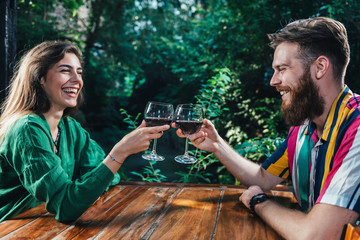 Couple Toasting With Red Wine On A Date