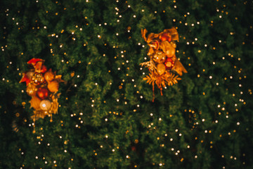 Wall Mural - Abstract blur background of vintage Christmas tree with ball decoration - light bokeh from Xmas tree at night party in winter. vintage color tone