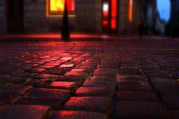 Old European illuminated city at rainy night