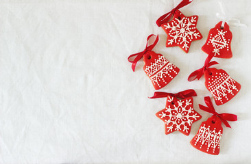 Christmas New Year holiday background, red gingerbread cookies on white table. Copy space.
