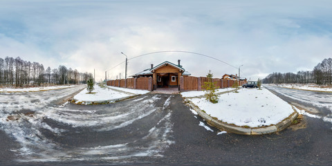 panorama 360 degrees angle view near gate of  wooden vacation house in the winter cloudy day in equirectangular projection, skybox VR AR content