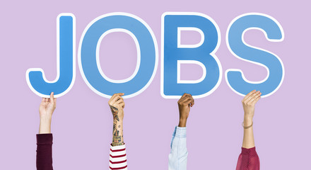Hands holding up blue letters forming the word jobs