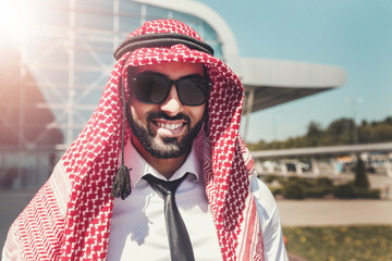 Portrait of arab man wears sunglasses and keffiyeh at the airport