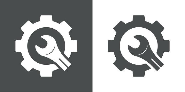 Icono plano engranaje con llave cortada en gris y blanco