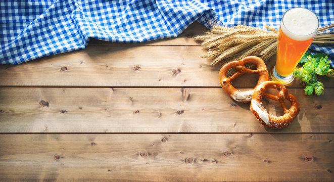 Oktoberfest background with Bavarian flag, beer glass and pretzel