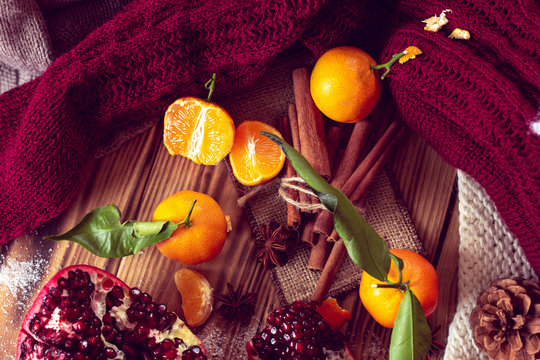 warm still life with tangerines and pomegranate