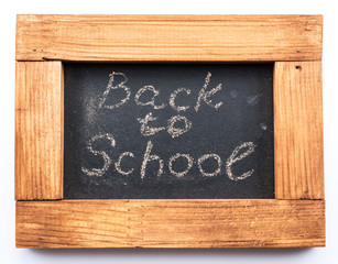 "Blackboard inscribed in chalk ""Back to school""."