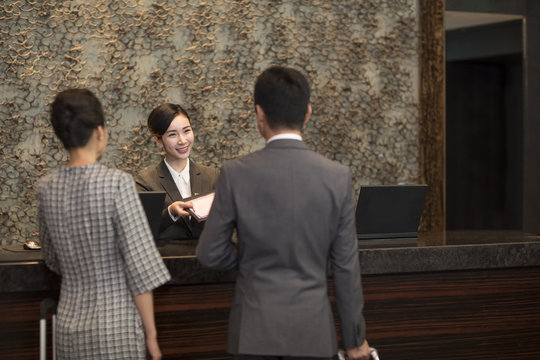 Couple checking into hotel