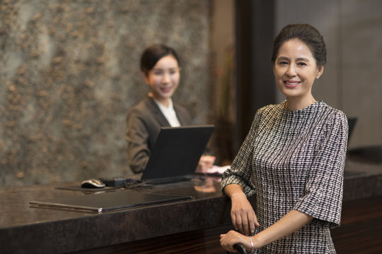 Elegant woman at hotel reception