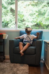 Boy using virtual reality headset in living room