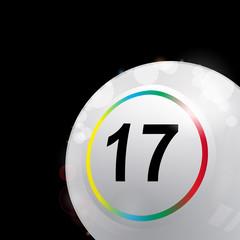 white bingo lotto ball in a corner of black background
