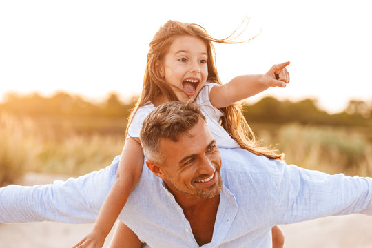 Cheerful father spending fun time with his little daughter