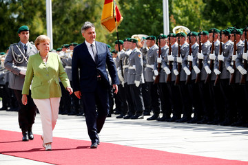 German Chancellor Merkel and Bosnia-Herzegovina's PM Zvizdic review the guard of honour at the chancellery in Berlin